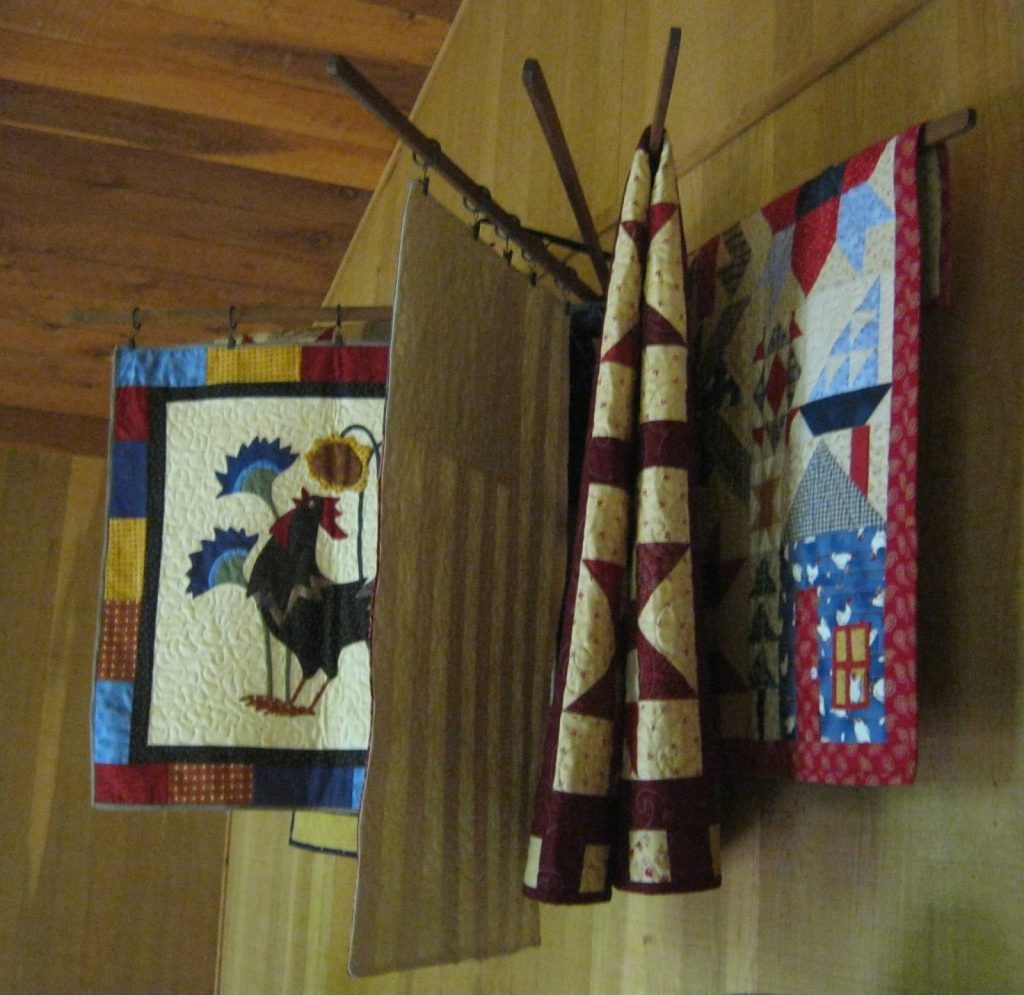 Quilts on drying rack found on chexztitches.blogspot.com